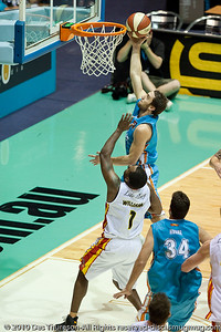 Adam Gibson over Corey Williams - Gold Coast Blaze v Melbourne Tigers NBL Basketball, Sunday 21 November 2010, GCCEC.