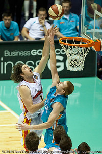 Wade Helliwell shoots over Tom Garlepp - Gold Coast Blaze v Melbourne Tigers NBL Basketball, Sunday 21 November 2010, GCCEC.