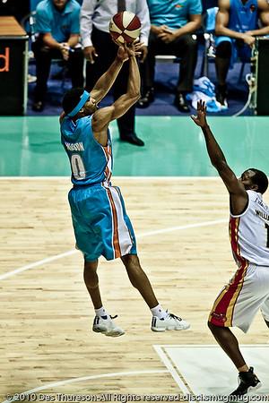 Darryl Hudson over Corey Williams  - Gold Coast Blaze v Melbourne Tigers NBL Basketball, Sunday 21 November 2010, GCCEC. (Dave Hill Temp)