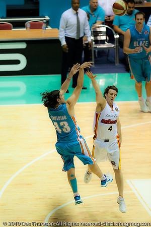 "Darryl Corletto has a 'soft & dreamy moment' defending Chris ""Bubbles"" Goulding - Gold Coast Blaze v Melbourne Tigers NBL Basketball, Sunday 21 November 2010, GCCEC. (PH Soft & Dreamy)"