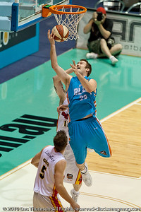 Mark Worthington with the reverse layup - Gold Coast Blaze v Melbourne Tigers NBL Basketball, Sunday 21 November 2010, GCCEC.