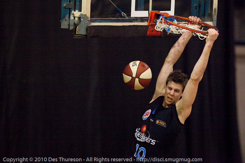 Tom Abercrombie with the athletic dunk - Gold Coast Blaze v New Zealand Breakers NBL basketball pre-season game; 4 October 2010, Carrara Stadium, Gold Coast, Queensland, Australia