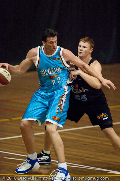 Stephen Hoare takes Gary Wilkinson down to the low post - Gold Coast Blaze v New Zealand Breakers NBL basketball pre-season game; 4 October 2010, Carrara Stadium, Gold Coast, Queensland, Australia