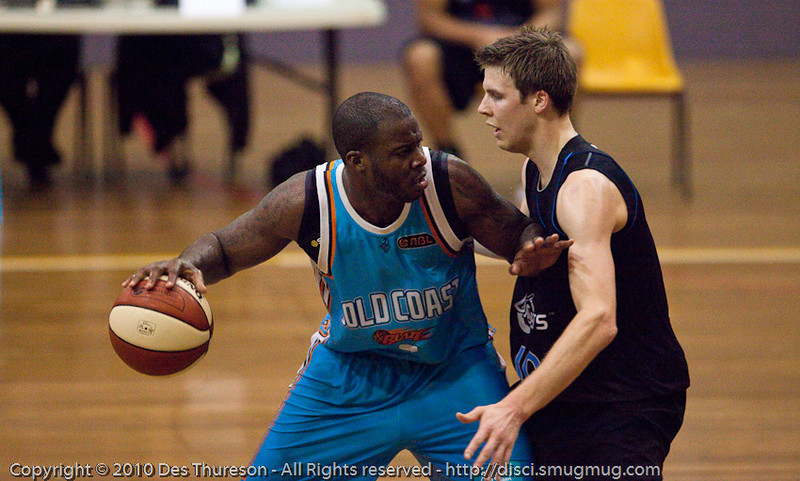Tom Abercrombie defends James Maye - Gold Coast Blaze v New Zealand Breakers NBL basketball pre-season game; 4 October 2010, Carrara Stadium, Gold Coast, Queensland, Australia