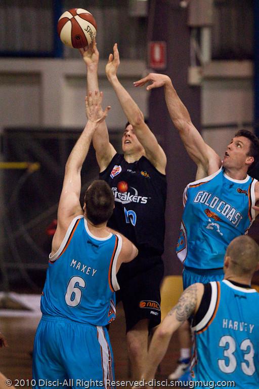 Stephen Hoare & Mark Worthingtom put the D on Tom Abercrombie - Gold Coast Blaze v New Zealand Breakers NBL basketball pre-season game; 4 October 2010, Carrara Stadium, Gold Coast, Queensland, Australia