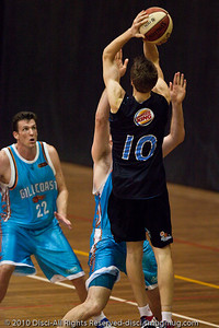 Thomas Abercrombie elevates and shoots against Mark Worthington - Gold Coast Blaze v New Zealand Breakers NBL basketball pre-season game; 4 October 2010, Carrara Stadium, Gold Coast, Queensland, Australia