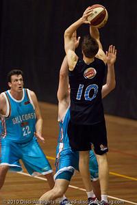 Thomas Abercrombie elevates and shoots against Mark Worthington - Gold Coast Blaze v New Zealand Breakers NBL basketball pre-season game; 4 October 2010, Carrara Stadium, Gold Coast, Queensland, Australia
