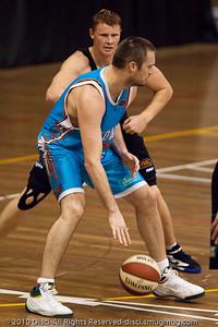 """Wortho"" goes inside against Gary Wilkinson - Gold Coast Blaze v New Zealand Breakers NBL basketball pre-season game; 4 October 2010, Carrara Stadium, Gold Coast, Queensland, Australia"