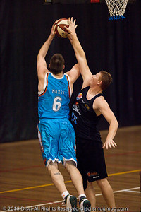 """Wortho"" goes inside against Gary Wilkinson - Gold Coast Blaze v New Zealand Breakers NBL basketball pre-season game; 4 October 2010, Carrara Stadium, Gold Coast, Queensland, Australia"