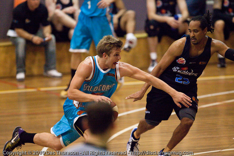 Shaun Gleeson v CJ Bruton - Gold Coast Blaze v New Zealand Breakers NBL basketball pre-season game; 4 October 2010, Carrara Stadium, Gold Coast, Queensland, Australia
