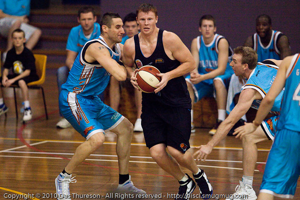 Gary Wilkinson strong inside against Pero Vasiljevic - Gold Coast Blaze v New Zealand Breakers NBL basketball pre-season game; 4 October 2010, Carrara Stadium, Gold Coast, Queensland, Australia