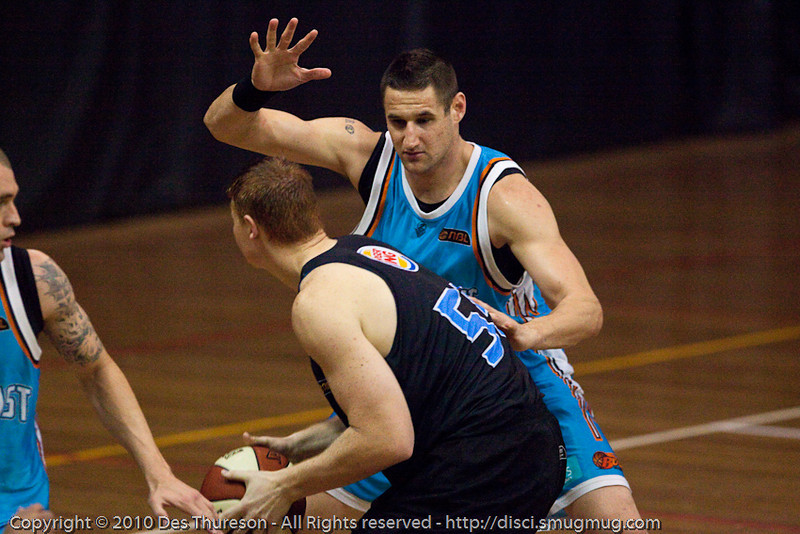 Pero Vasiljevic plays D on Gary Wilkinson in the low post - Gold Coast Blaze v New Zealand Breakers NBL basketball pre-season game; 4 October 2010, Carrara Stadium, Gold Coast, Queensland, Australia