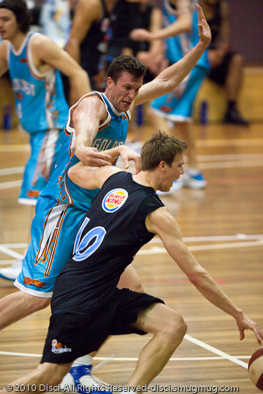 Stephen Hoare tries to check the penetration of Tom Abercrombie - Gold Coast Blaze v New Zealand Breakers NBL basketball pre-season game; 4 October 2010, Carrara Stadium, Gold Coast, Queensland, Australia