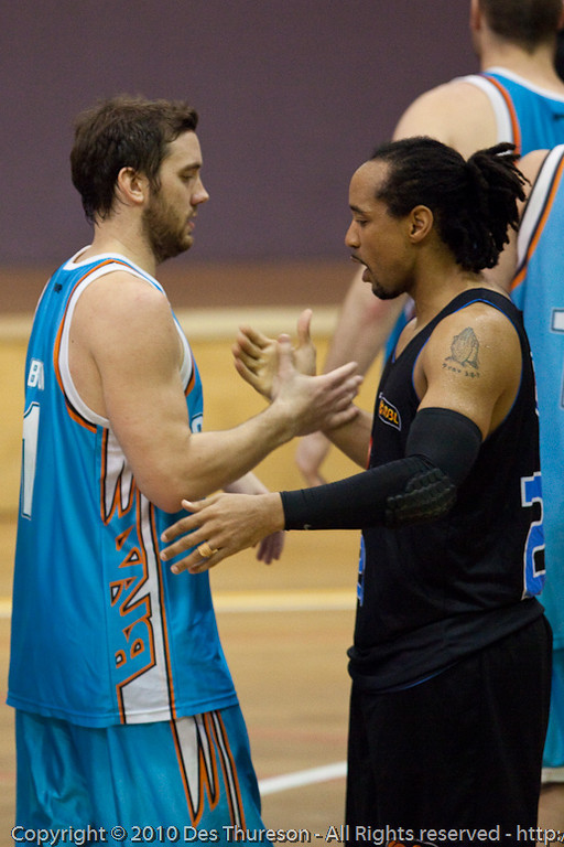 Former NBL Championship-winning guards from the Brisbane Bullets, CJ Bruton and Adam Gibson - Gold Coast Blaze v New Zealand Breakers NBL basketball pre-season game; 4 October 2010, Carrara Stadium, Gold Coast, Queensland, Australia