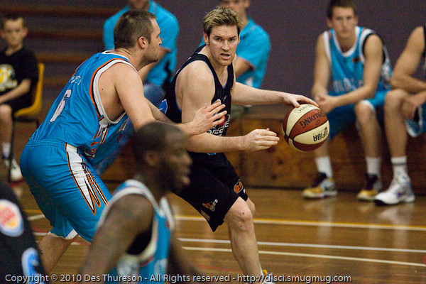 Dillon Boucher with the excellent court-vision from the low post - Gold Coast Blaze v New Zealand Breakers NBL basketball pre-season game; 4 October 2010, Carrara Stadium, Gold Coast, Queensland, Australia