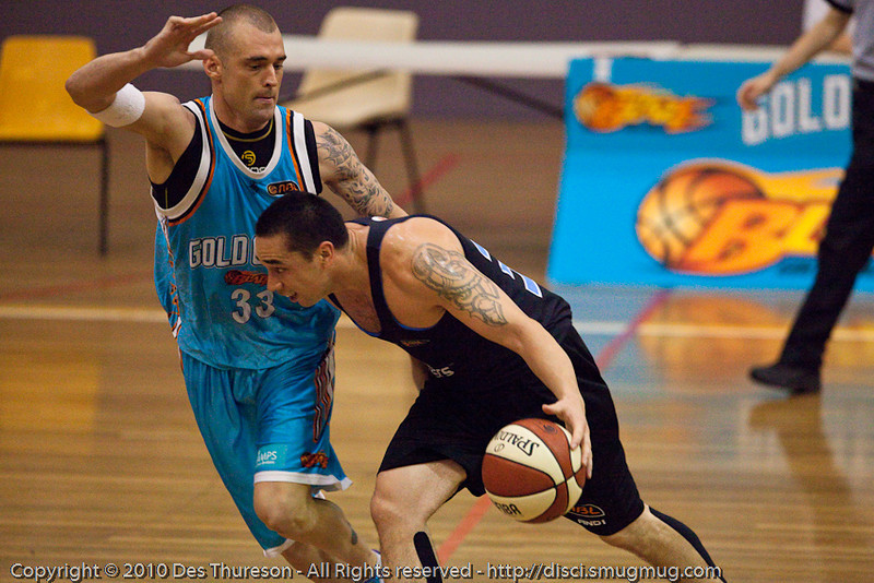 Paul Henare v James Harvey - Gold Coast Blaze v New Zealand Breakers NBL basketball pre-season game; 4 October 2010, Carrara Stadium, Gold Coast, Queensland, Australia