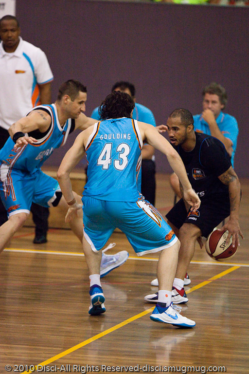 Kevin Braswell keeps his eyes up against the double team of Chris Goulding and Pero Vasiljevic - Gold Coast Blaze v New Zealand Breakers NBL basketball pre-season game; 4 October 2010, Carrara Stadium, Gold Coast, Queensland, Australia