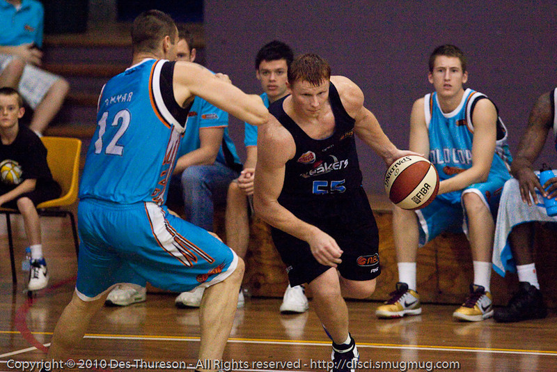Gary Wilkinson strong inside against Pero Vasiljevic - Gold Coast Blaze v New Zealand Breakers NBL basketball pre-season game; 4 October 2010, Carrara Stadium, Gold Coast, Queensland, Australia