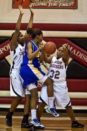 Groveport Madison High School's #34 Kourtni Perry, left, and # 32 Teryn Conner tries to block a driving Gahanna Jefferson High School's #34 Zenobia Bess in the first period of play at Groveport Madison High School Friday night January 15, 2010. (Photo by James D. DeCamp 614-462-8027)