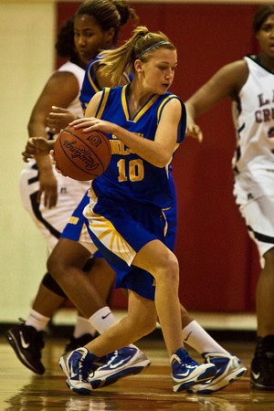 Gahanna Jefferson High School's #10 Ashley Gogolin fights through heavy traffic in the first period of play at Groveport Madison High School Friday night January 15, 2010. (Photo by James D. DeCamp 614-462-8027)