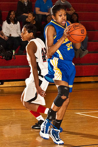 Gahanna Jefferson High School's #30 Chrishna Butler pulls in a rebound in the second period of play at Groveport Madison High School Friday night January 15, 2010. in the rear is Groveport Madison High School's #42 Donika Williams. (Photo by James D. DeCamp 614-462-8027)