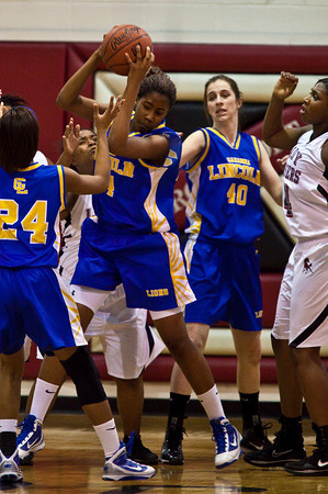 Gahanna Jefferson High School's #34 Zenobia Best pulls down a rebound in the first period of play at Groveport Madison High School Friday night January 15, 2010. (Photo by James D. DeCamp 614-462-8027)