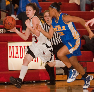 Groveport Madison High School's #3 Kelsey Fridley is run down by Gahanna Jefferson High School's #32 Renya Montgomery in the first period of play at Groveport Madison High School Friday night January 15, 2010. (Photo by James D. DeCamp 614-462-8027)