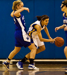 Olentangy High School's #23 Olivia Zwayer tries to make it around Marysville High School's #24 Sarah VanVoorhis in the first period of play at Olentangy High School Tuesday night January 26, 2010. (Photo by James D. DeCamp 614-462-8027)