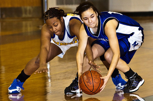 Olentangy High School's #25 Embrye Cheek and Marysville High School's #10 Elizabeth Lewis vie for a loose ball in the first period of play at Olentangy High School Tuesday night January 26, 2010. (Photo by James D. DeCamp 614-462-8027)