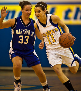 Olentangy High School's #11 Brooke Zwayer tries to make it around Marysville High School's #33 Lindy Howard  in the first period of play at Olentangy High School Tuesday night January 26, 2010. (Photo by James D. DeCamp 614-462-8027)