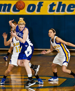 Olentangy High School's #12 Jamie Richardson and #11 Brooke Zwayerreact to a loose ball from the hands of Marysville High School's #25 Jenny Jordan in the first period of play at Olentangy High School Tuesday night January 26, 2010. (Photo by James D. DeCamp 614-462-8027)