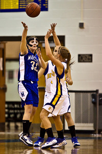 Olentangy High School's #12 Jamie Richardson and #1 Christine Delaney guard Marysville High School's #32 Chelsey Wyman in the first period of play at Olentangy High School Tuesday night January 26, 2010. (Photo by James D. DeCamp 614-462-8027)