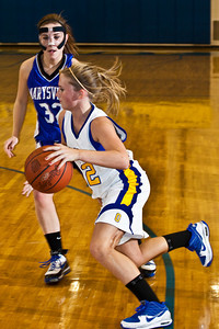 Olentangy High School's #12 Jamie Richardson drives past Marysville High School's #32 Chelsey Wyman  in the second period of play at Olentangy High School Tuesday night January 26, 2010. (Photo by James D. DeCamp 614-462-8027)
