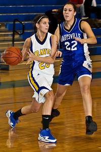 Olentangy High School's #23 Olivia Zwayer looks for a teammate to pass to with Marysville High School's #22 Alex Yanscik on guard in the first period of play at Olentangy High School Tuesday night January 26, 2010. (Photo by James D. DeCamp 614-462-8027)
