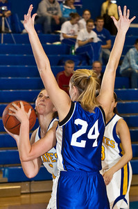 Olentangy High School's #1 Christine Delaney tries to make it around Marysville High School's #24 Sarah VanVoorhis in the second period of play at Olentangy High School Tuesday night January 26, 2010. (Photo by James D. DeCamp 614-462-8027)