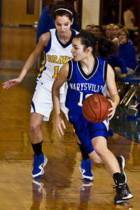 Olentangy High School's #11 Brooke Zwayer shadows Marysville High School's #10 Elizabeth Lewis in the first period of play at Olentangy High School Tuesday night January 26, 2010. (Photo by James D. DeCamp 614-462-8027)