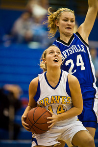 Olentangy High School's #14 Emily Raiff makes it around Marysville High School's #24 Sarah VanVoorhis  in the first period of play at Olentangy High School Tuesday night January 26, 2010. (Photo by James D. DeCamp 614-462-8027)