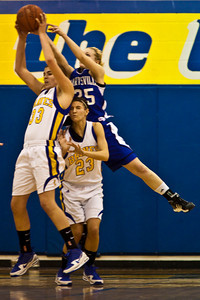 Olentangy High School's #23 Olivia Zwayer gets caught in the middle of #33 Lydia Hyburg and Marysville High School's #25 Jenny Jordan  in the second period of play at Olentangy High School Tuesday night January 26, 2010. (Photo by James D. DeCamp 614-462-8027)