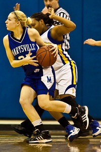 Olentangy High School's #25 Embrye Cheek  tries to make block a driving Marysville High School's #25 Jenny Jordan in the second period of play at Olentangy High School Tuesday night January 26, 2010. (Photo by James D. DeCamp 614-462-8027)