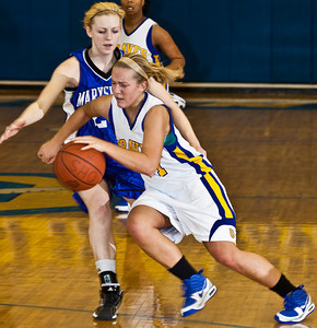 Olentangy High School's #14 Emily Raiff  tries to make it around Marysville High School's #25 Jenny Jordan in the first period of play at Olentangy High School Tuesday night January 26, 2010. (Photo by James D. DeCamp 614-462-8027)