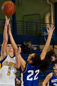 Olentangy High School's #1 Christine Delaney and Marysville High School's #22 Alex Yanscik vie for a rebound in the first period of play at Olentangy High School Tuesday night January 26, 2010. (Photo by James D. DeCamp 614-462-8027)