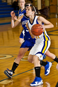 Olentangy High School's #11 Brooke Zwayer is shadowed by  Marysville High School's #32 Chelsey Wyman in the first period of play at Olentangy High School Tuesday night January 26, 2010. (Photo by James D. DeCamp 614-462-8027)