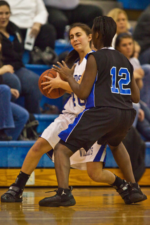 Hilliard Davidson High School's #40 Kelsey Sicker is guarded by Central Crossings High School's #12 Jalynn Graham in the second period of play at Hilliard Davidson High School Friday night January 29, 2010. (Photo by James D. DeCamp 614-462-8027)