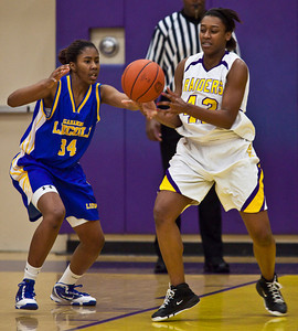 Reynoldsburg High School's #42 Destini Cooper tries to get around Gahanna Jefferson High School's #34 Zenobia Bess in the first period of play at Reynoldsburg High School Friday night February 12, 2010. (Photo by James D. DeCamp 614-462-8027)