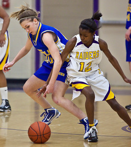 Reynoldsburg High School's #12 Yamonie Jenkins and Gahanna Jefferson High School's #10 Ashley Gogolin vie for a loose ball in the second period of play at Reynoldsburg High School Friday night February 12, 2010. (Photo by James D. DeCamp 614-462-8027)
