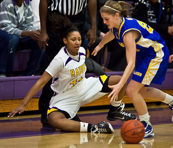 Reynoldsburg High School's #42 Destini Cooper is knocked out of bounds by Gahanna Jefferson High School's #20 Casey Salopek in the first period of play at Reynoldsburg High School Friday night February 12, 2010. (Photo by James D. DeCamp 614-462-8027)