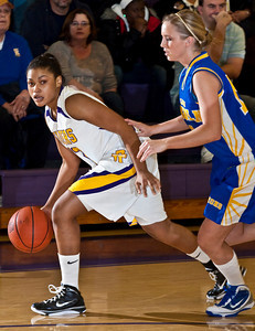 Reynoldsburg High School's #32 Kenyell Goodson tries to make her way around Gahanna Jefferson High School's #15 Jillian O'Donnell in the first period of play at Reynoldsburg High School Friday night February 12, 2010. (Photo by James D. DeCamp 614-462-8027)
