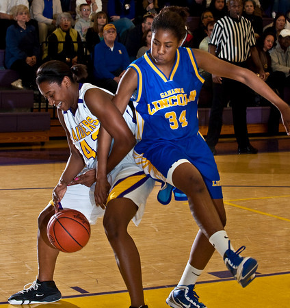 Reynoldsburg High School's #42 Destini Cooper is guarded by  Gahanna Jefferson High School's #34 Zenobia Bess in the first period of play at Reynoldsburg High School Friday night February 12, 2010. (Photo by James D. DeCamp 614-462-8027)