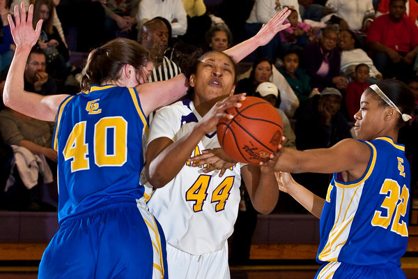Reynoldsburg High School's #44 T'Shera Lucas tries to make her way between Gahanna Jefferson High School's #40 Haley Schmitt and #32 Renya Montgomery in the second period of play at Reynoldsburg High School Friday night February 12, 2010. (Photo by James D. DeCamp 614-462-8027)