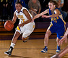 Reynoldsburg High School's #32 Kenyell Goodson drives to the basket with Gahanna Jefferson High School's #10 Ashley Gogolin in pursuit in the second period of play at Reynoldsburg High School Friday night February 12, 2010. (Photo by James D. DeCamp 614-462-8027)